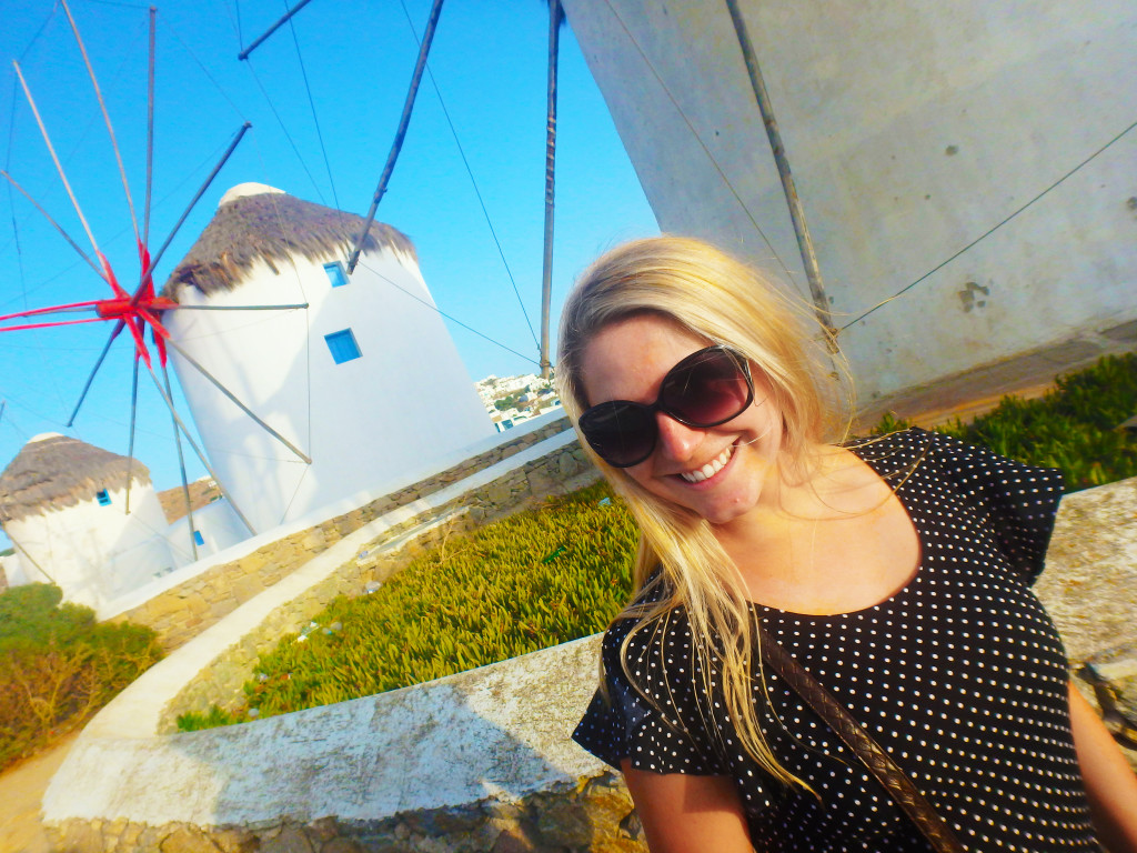 Chloe in Mykonos Town next to windmills - Time Travel Blonde