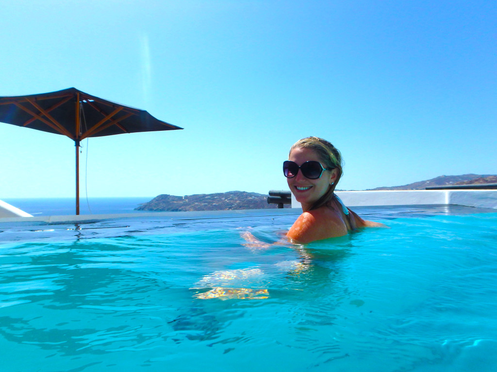 Myconian Utopia - Chloe in Inifinity Pool overlooking the aegean sea - Mykonos Greece - time travel blonde